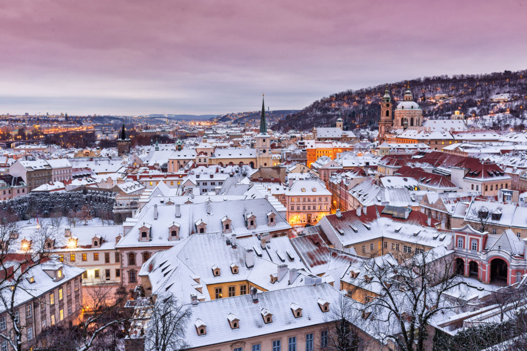 Prague in winter time, view on snowy roofs.